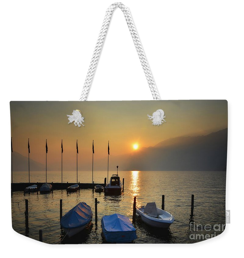 Port Weekender Tote Bag featuring the photograph Harbor On A Foggy Lake by Mats Silvan
