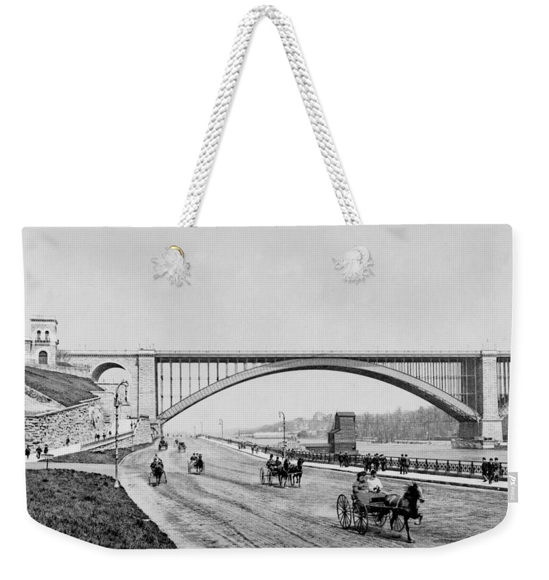 george Washington Bridge Weekender Tote Bag featuring the photograph Harlem River Speedway Scene Beneath The George Washington Bridge by International Images