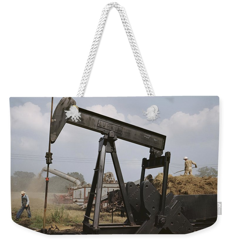 oil Industry And Production Weekender Tote Bag featuring the photograph Harvestors Trash Fields While Black by B. Anthony Stewart