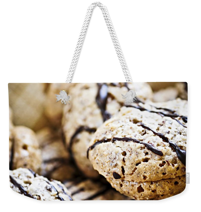 Cookie Weekender Tote Bag featuring the photograph Hazelnut Cookies by Elena Elisseeva