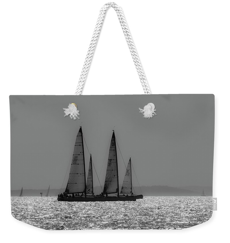 Solent Weekender Tote Bag featuring the photograph Heading Home Bramble Bank by Gary Eason