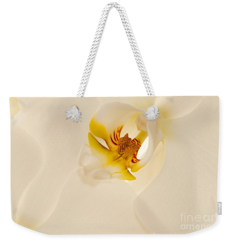Bronstein Weekender Tote Bag featuring the photograph Heart Of The Orchid by Sandra Bronstein