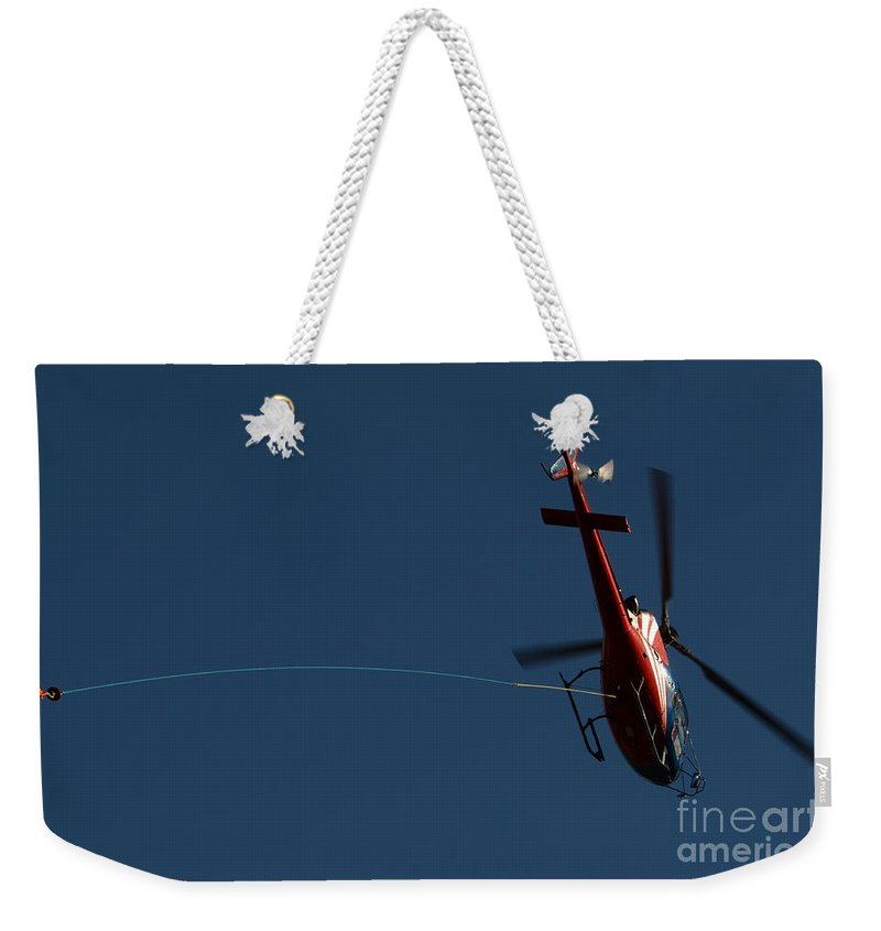 Helicopter Weekender Tote Bag featuring the photograph Helicopter With A Hook by Mats Silvan