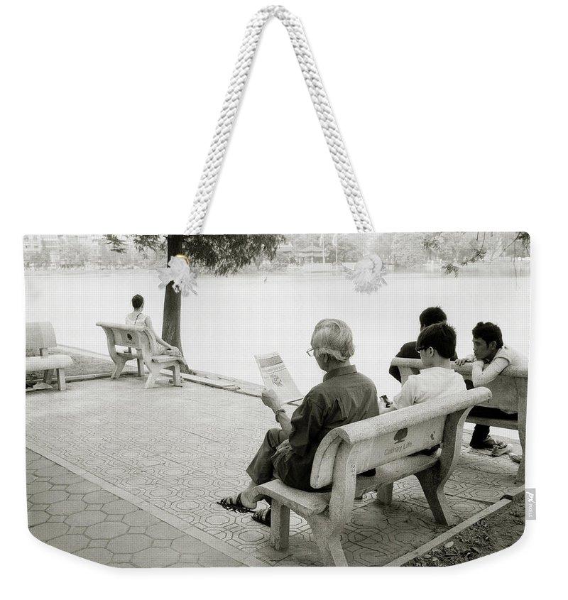 Serenity Weekender Tote Bag featuring the photograph Hoan Kiem Lake by Shaun Higson