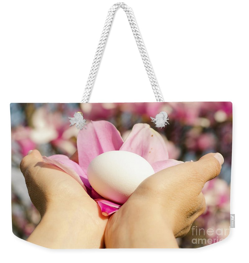 Hands Weekender Tote Bag featuring the photograph Holding Careful A White Egg by Mats Silvan