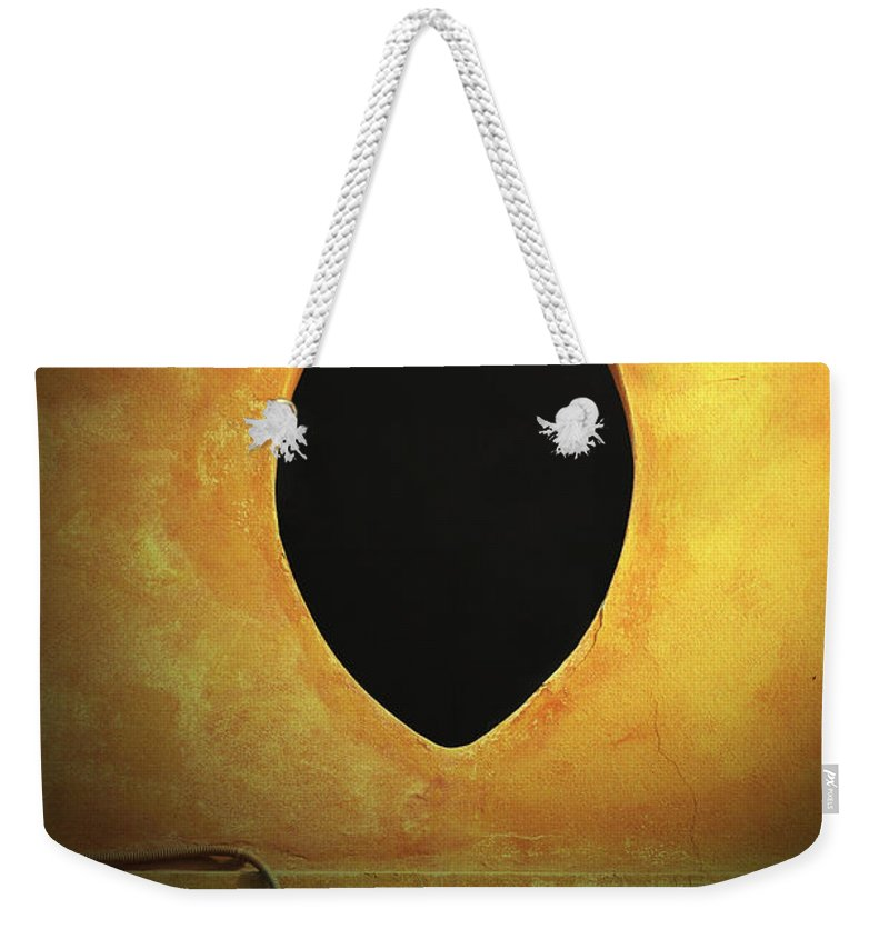 Hole Weekender Tote Bag featuring the photograph Hole In The Wall With Lamp by Mike Nellums