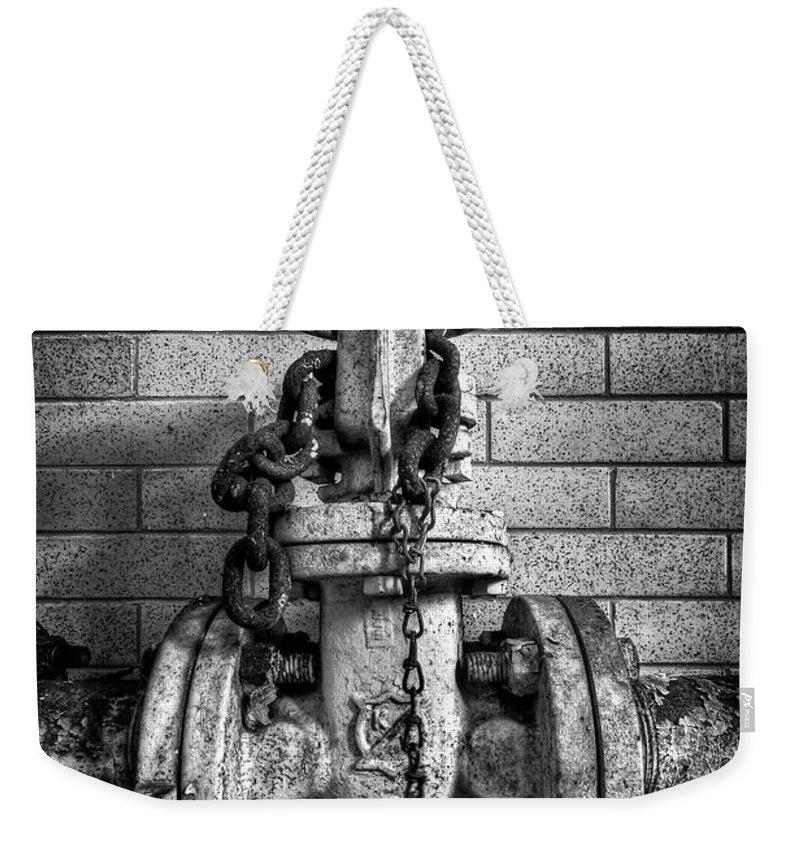 Metal Weekender Tote Bag featuring the photograph Hooked On Metal by Evelina Kremsdorf