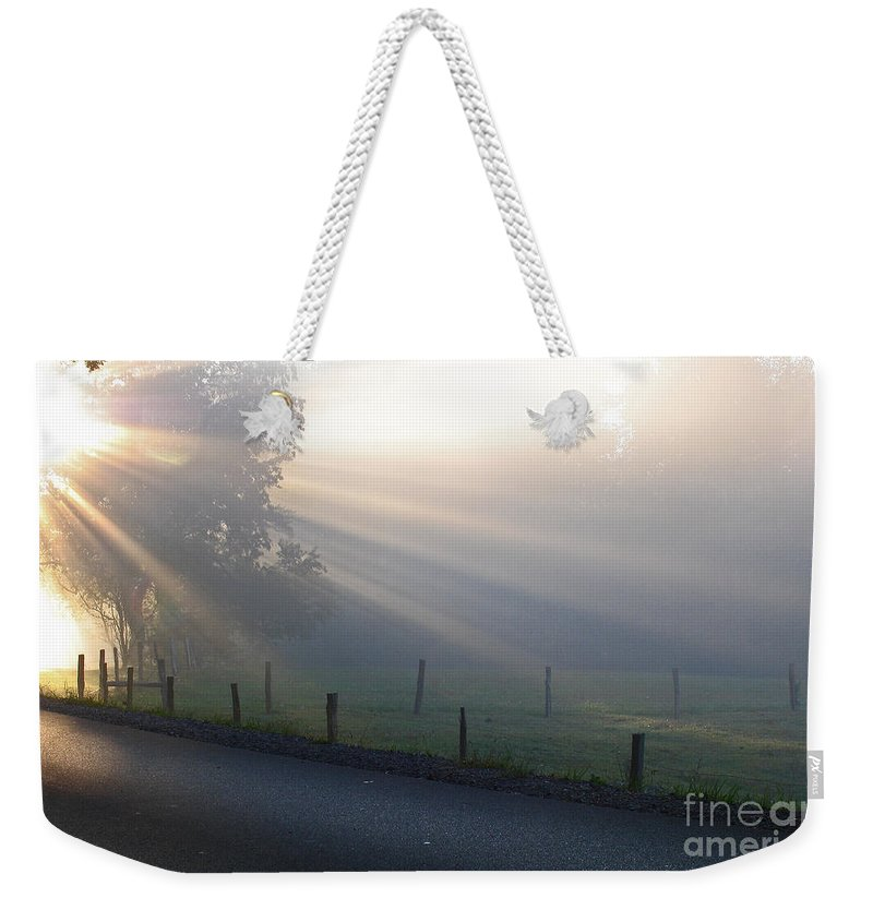 Light Weekender Tote Bag featuring the photograph Hope Is In His Light by Douglas Stucky