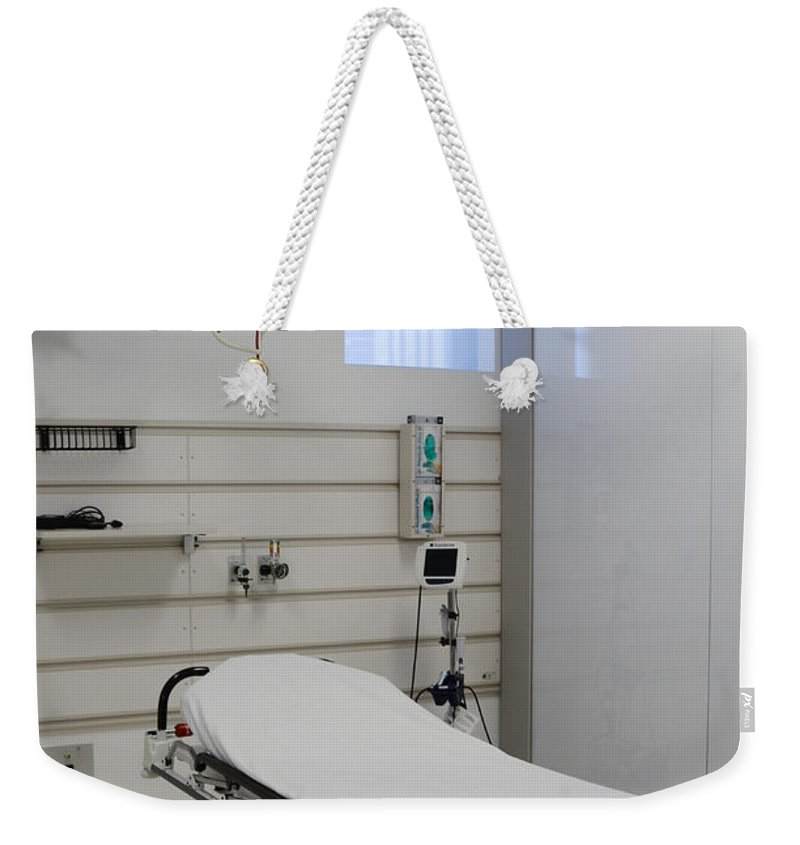 Adjust Weekender Tote Bag featuring the photograph Hospital Gurney by Photo Researchers, Inc.