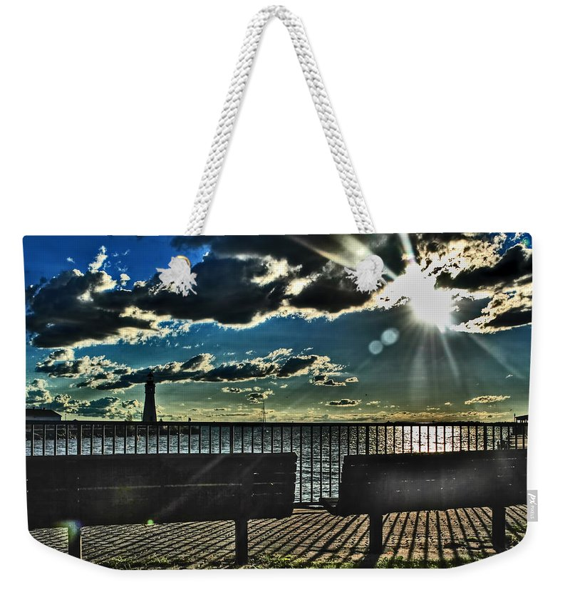 Weekender Tote Bag featuring the photograph How Long Must I Wait by Michael Frank Jr