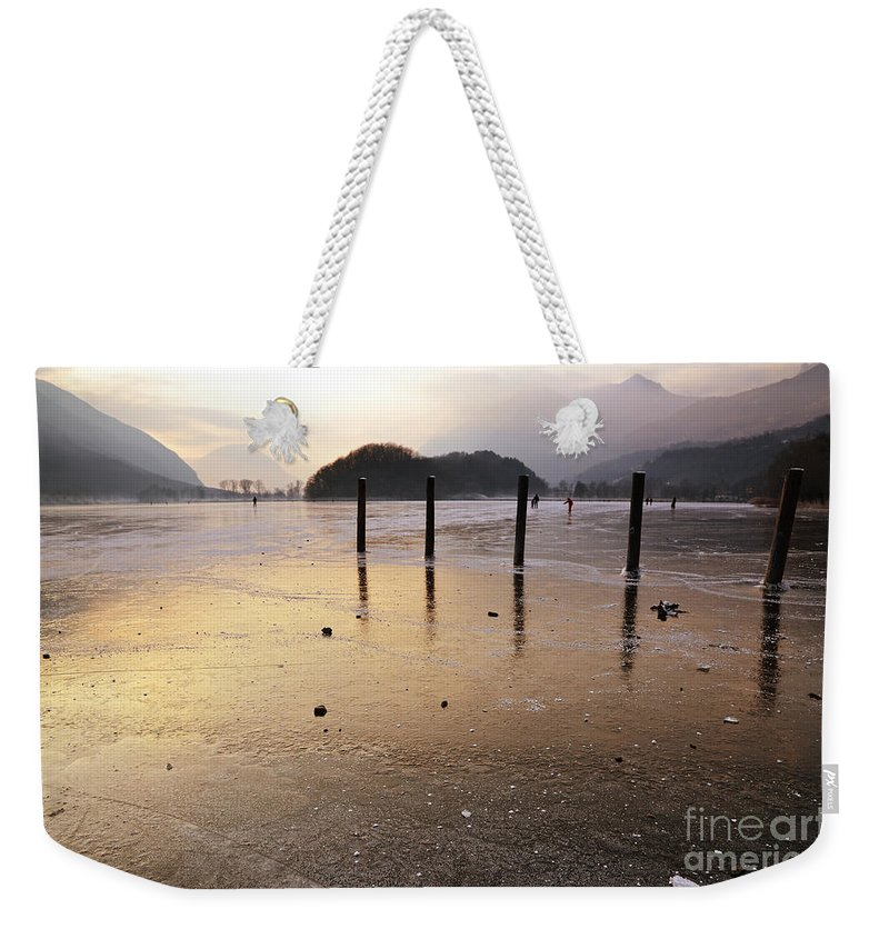 Frost Weekender Tote Bag featuring the photograph Ice On A Lake In Sunset by Mats Silvan