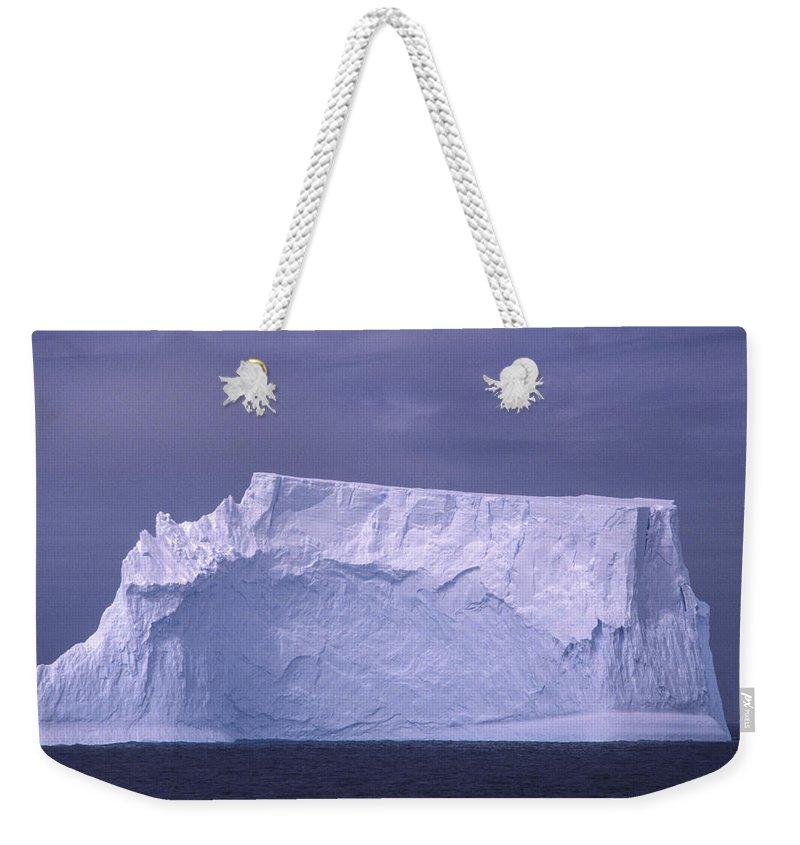 Antarctic Peninsula Weekender Tote Bag featuring the photograph Iceberg Antarctica by Boyd Norton
