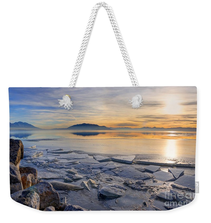 Utah Lake Weekender Tote Bag featuring the photograph Icy Sunset On Utah Lake by Gary Whitton