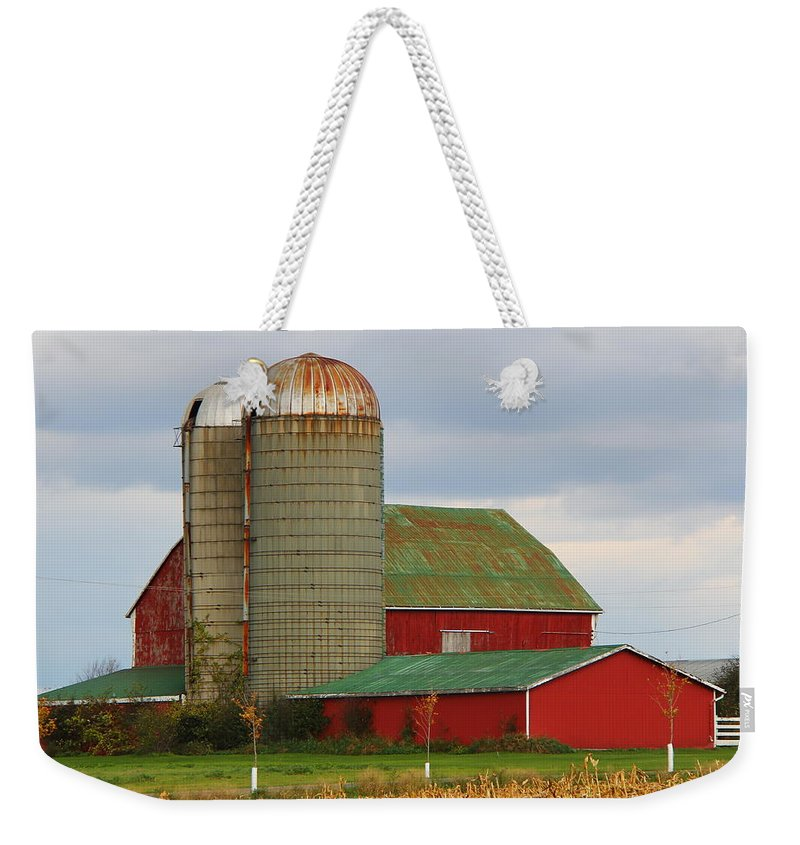 Barn Weekender Tote Bag featuring the photograph In Farmer's Field by Davandra Cribbie