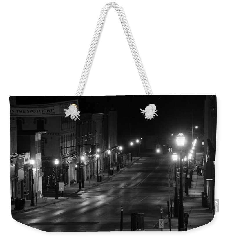 City Weekender Tote Bag featuring the photograph In The Spotlight by Davandra Cribbie