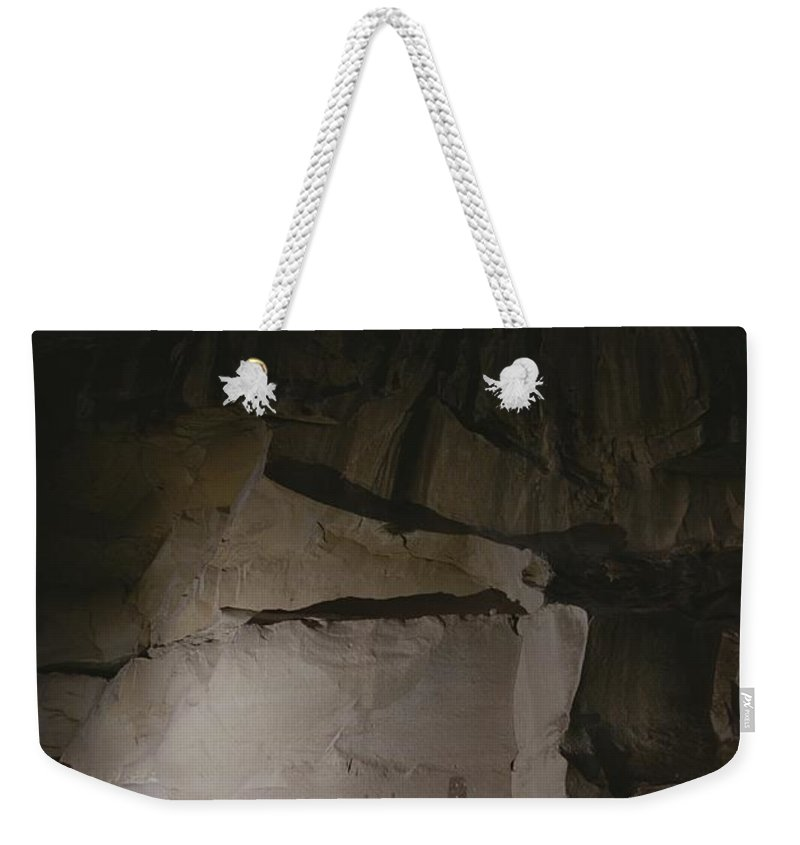 North America Weekender Tote Bag featuring the photograph Indian Pictographs Are Illuminated by Stephen Alvarez
