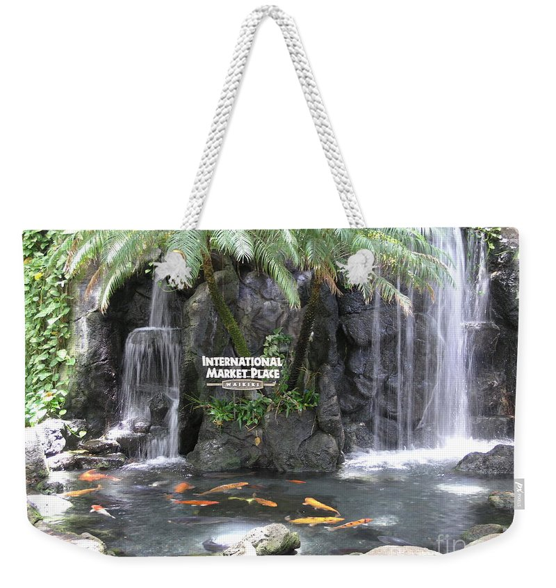 Honolulu Weekender Tote Bag featuring the photograph International Marketplace - Waikiki by Mary Deal