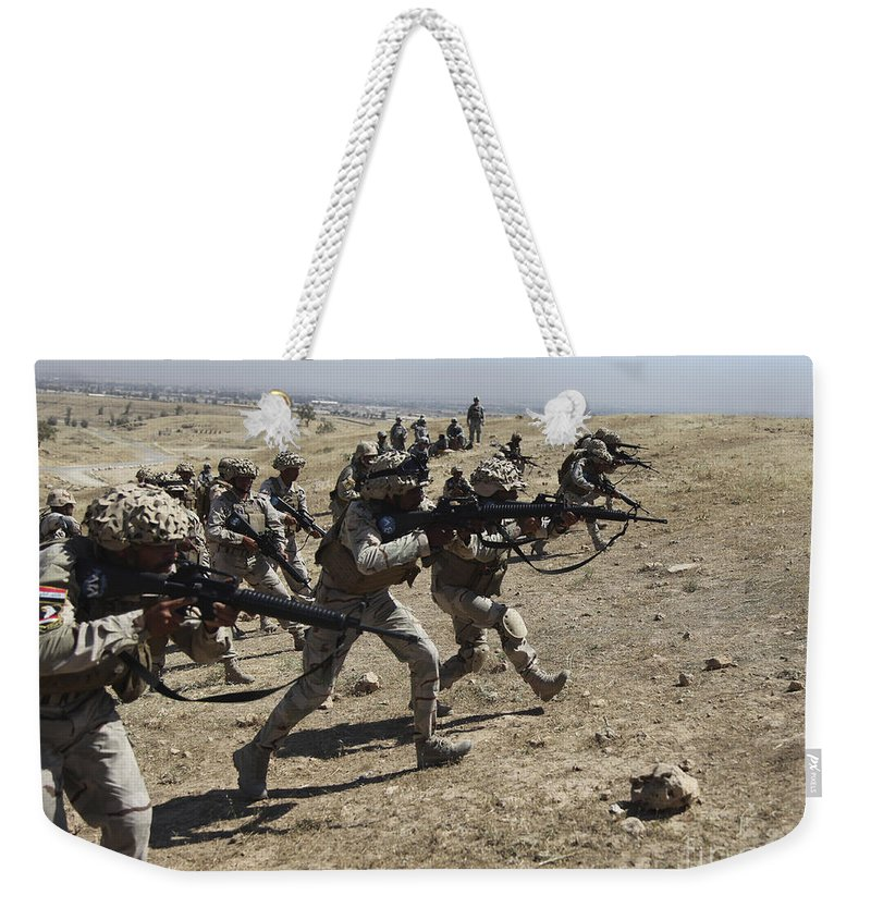 Iraq Weekender Tote Bag featuring the photograph Iraqi Army Soldiers Move To Positions by Stocktrek Images