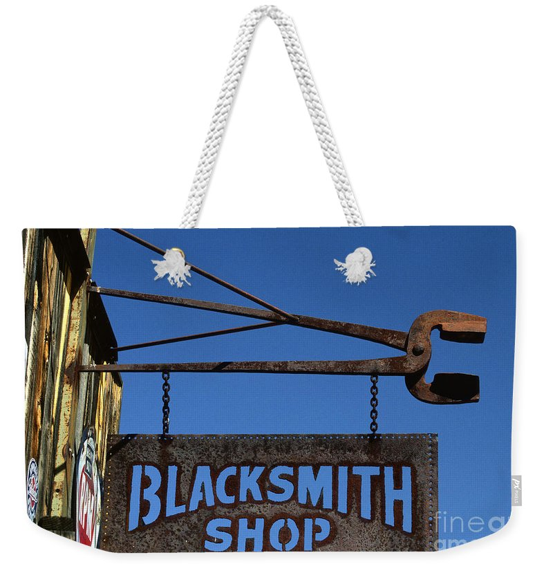 Bronstein Weekender Tote Bag featuring the photograph Iron Signage by Sandra Bronstein