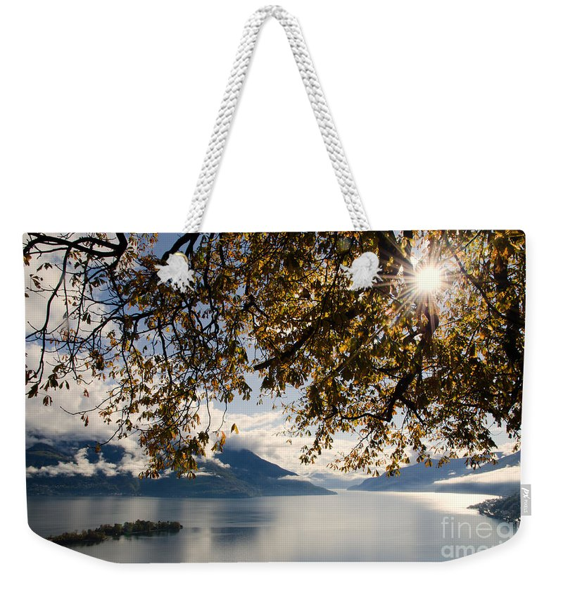 Islands Weekender Tote Bag featuring the photograph Islands On A Lake In Autumn by Mats Silvan