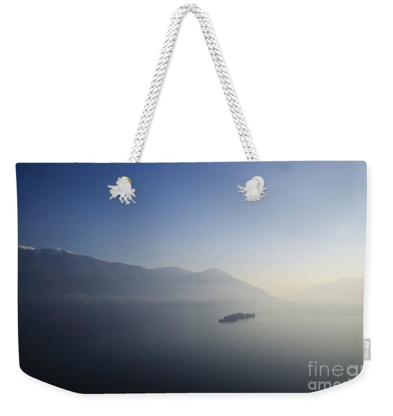 Islands Weekender Tote Bag featuring the photograph Islands On A Lake With Mountain by Mats Silvan