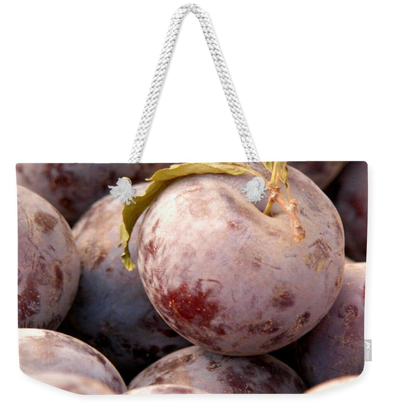 Agriculture Weekender Tote Bag featuring the photograph Italian Plums At Market by Jeelan Clark