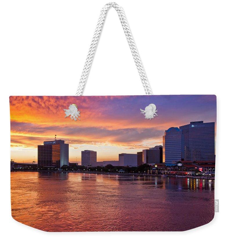 Clouds Weekender Tote Bag featuring the photograph Jacksonville Skyline At Dusk by Debra and Dave Vanderlaan