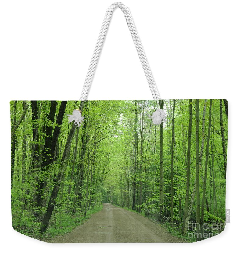 Green Weekender Tote Bag featuring the photograph Jasper Woods by Ronald Grogan