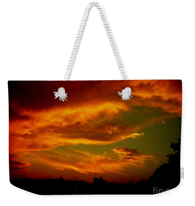 Sunset Weekender Tote Bag featuring the photograph July 21 2010 by Mark Gilman