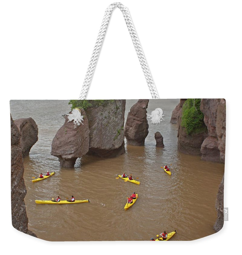 Hopewell Rocks Weekender Tote Bag featuring the photograph Kayaks At Hopewell Rocks by Ted Kinsman