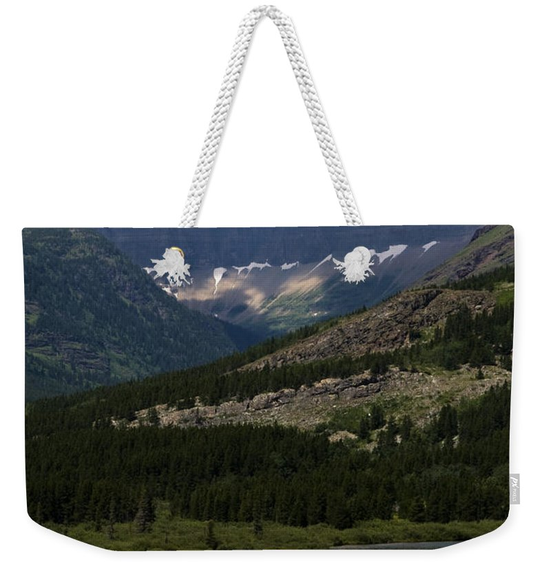 Red And Blue Kayakers Weekender Tote Bag featuring the photograph Kayaks On Swiftcurrent Lake by Lorraine Devon Wilke