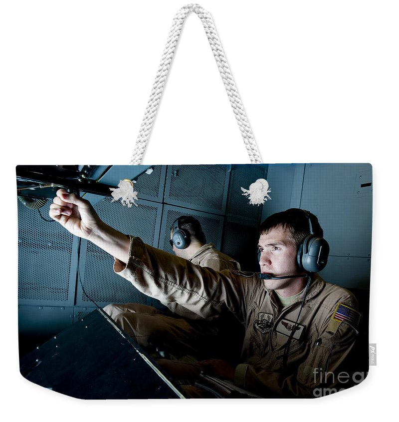 Military Weekender Tote Bag featuring the photograph Kc-10 Extender Boom Operator Adjusts by Stocktrek Images