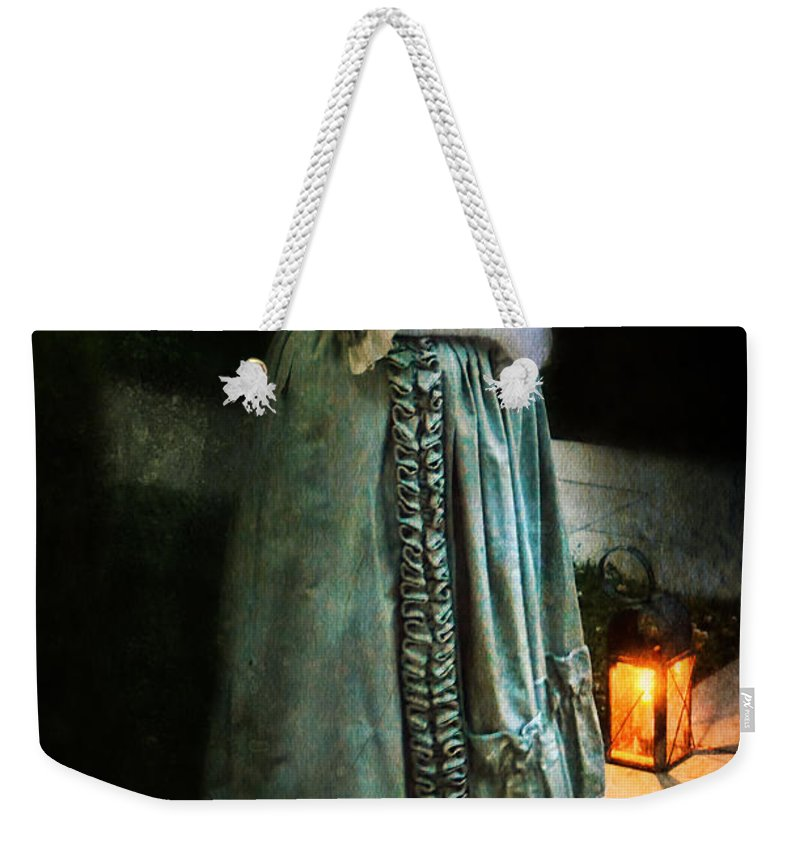 Lady Weekender Tote Bag featuring the photograph Lady By Lantern Light by Jill Battaglia