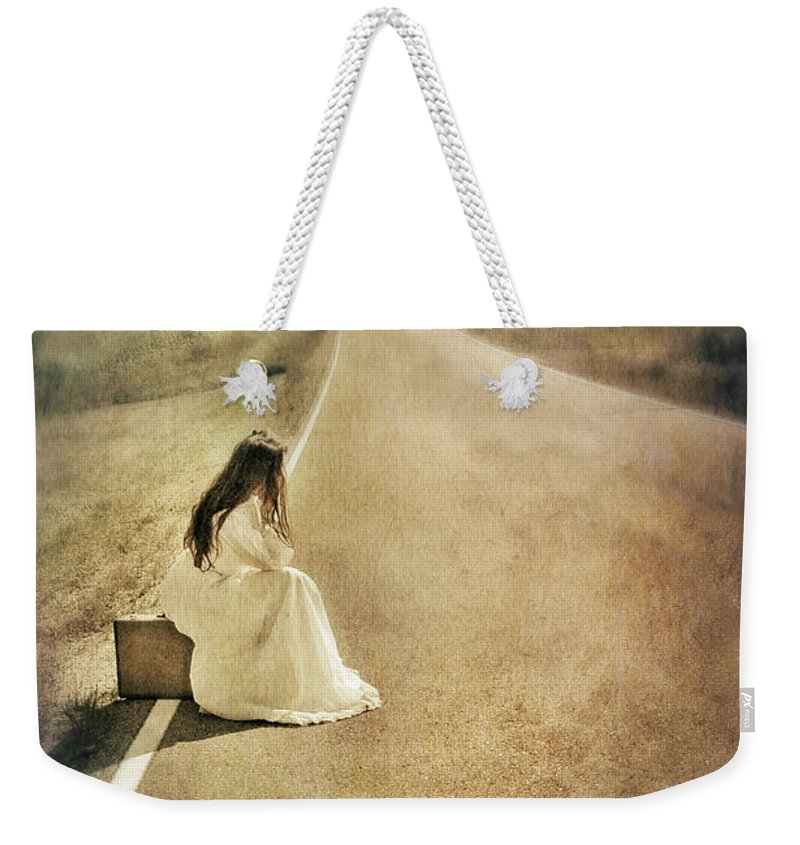 Woman Weekender Tote Bag featuring the photograph Lady In Gown Sitting By Road On Suitcase by Jill Battaglia