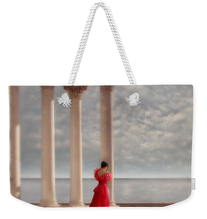 Woman Weekender Tote Bag featuring the photograph Lady In Red Gown By The Sea by Jill Battaglia