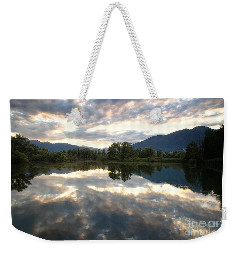 Lake Weekender Tote Bag featuring the photograph Lake With Clouds by Mats Silvan