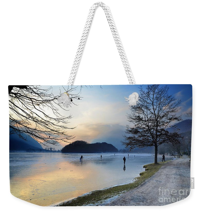 Ice Weekender Tote Bag featuring the photograph Lake With Ice by Mats Silvan
