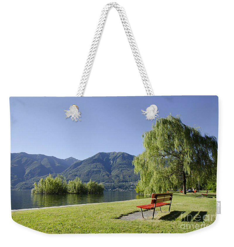 Bench Weekender Tote Bag featuring the photograph Lakefront With Mountain by Mats Silvan