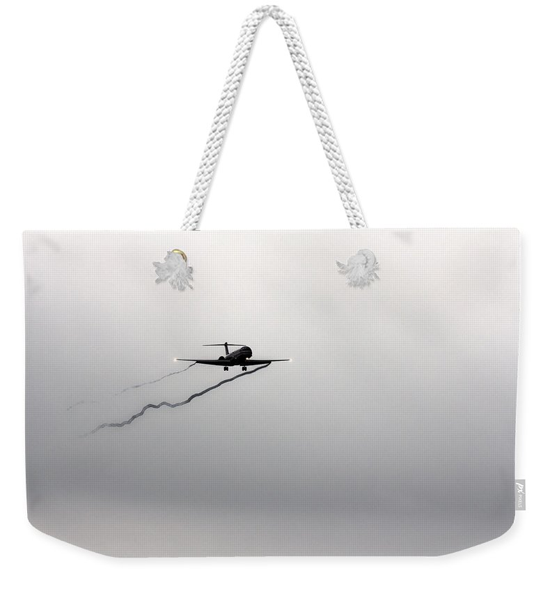 American Airlines-the Mcdonnell Douglas Md-81/82/83/88 Weekender Tote Bag featuring the photograph Landing Approach In Bad Weather by Douglas Barnard