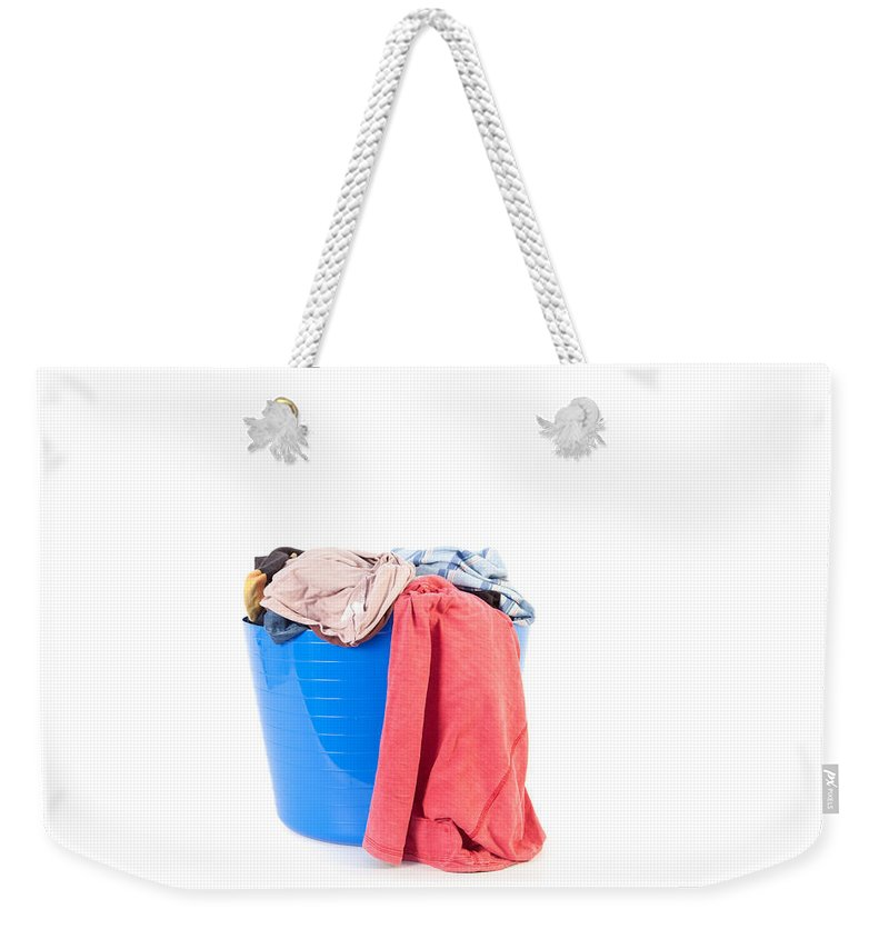 Background Weekender Tote Bag featuring the photograph Laundry by Tom Gowanlock