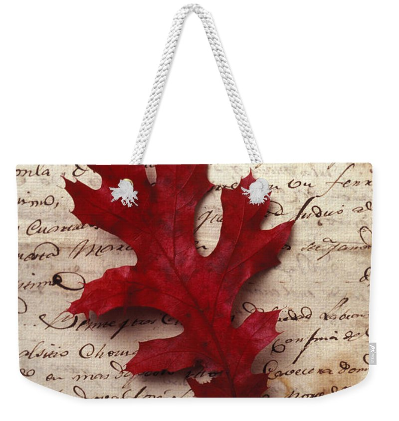 Leaf Weekender Tote Bag featuring the photograph Leaf On Letter by Garry Gay