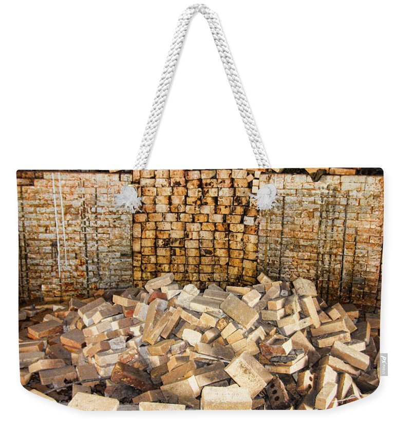 Antique Weekender Tote Bag featuring the photograph Left Over Brick In Antique Brick Kiln by Kathy Clark