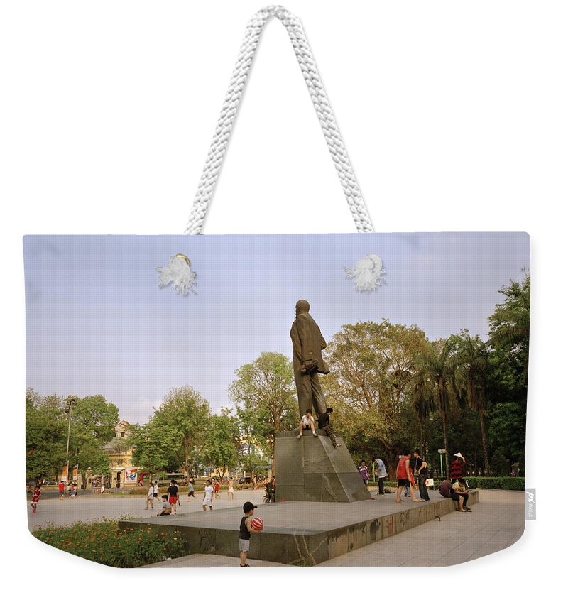 Asia Weekender Tote Bag featuring the photograph Lenin In Hanoi by Shaun Higson