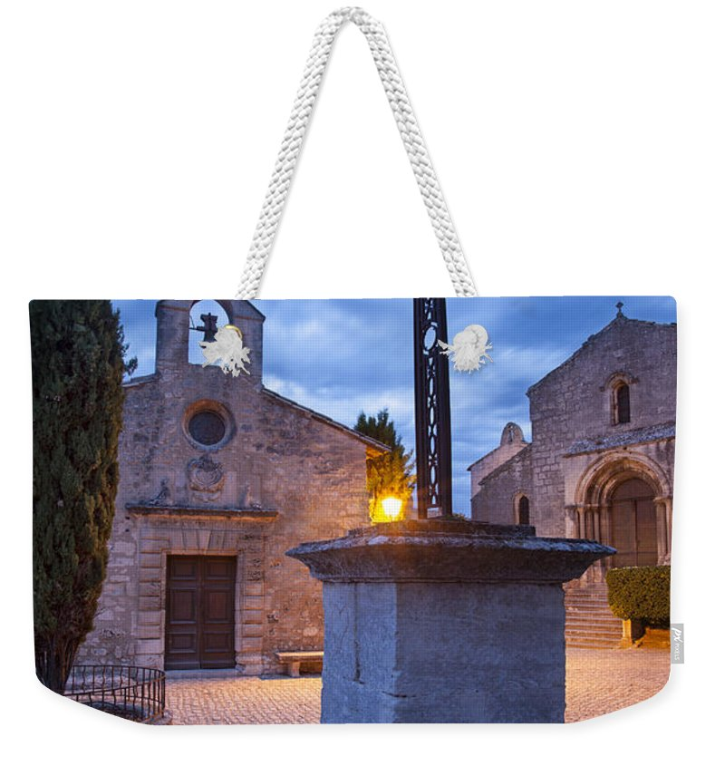 Chapel Weekender Tote Bag featuring the photograph Les Baux Iron Cross by Brian Jannsen