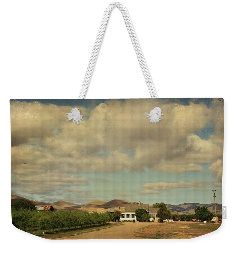 Landscapes Weekender Tote Bag featuring the photograph Let's Run Through The Orchard by Laurie Search