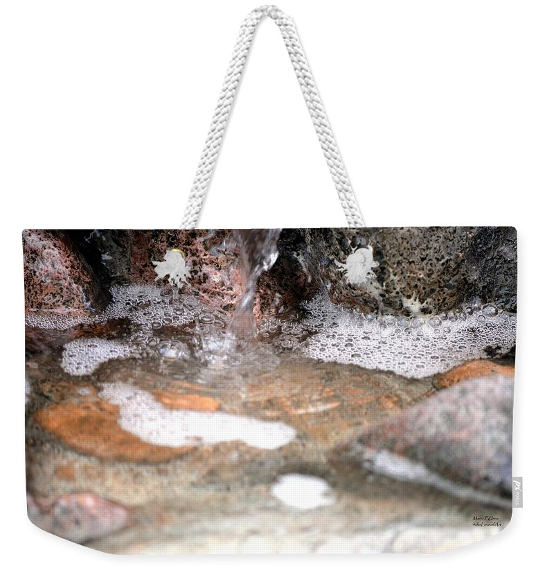 Letting Weekender Tote Bag featuring the photograph Letting Go by Maria Urso