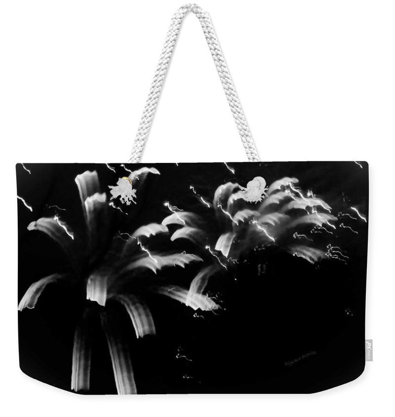 Fireworks Weekender Tote Bag featuring the photograph Licorice Sky by DigiArt Diaries by Vicky B Fuller