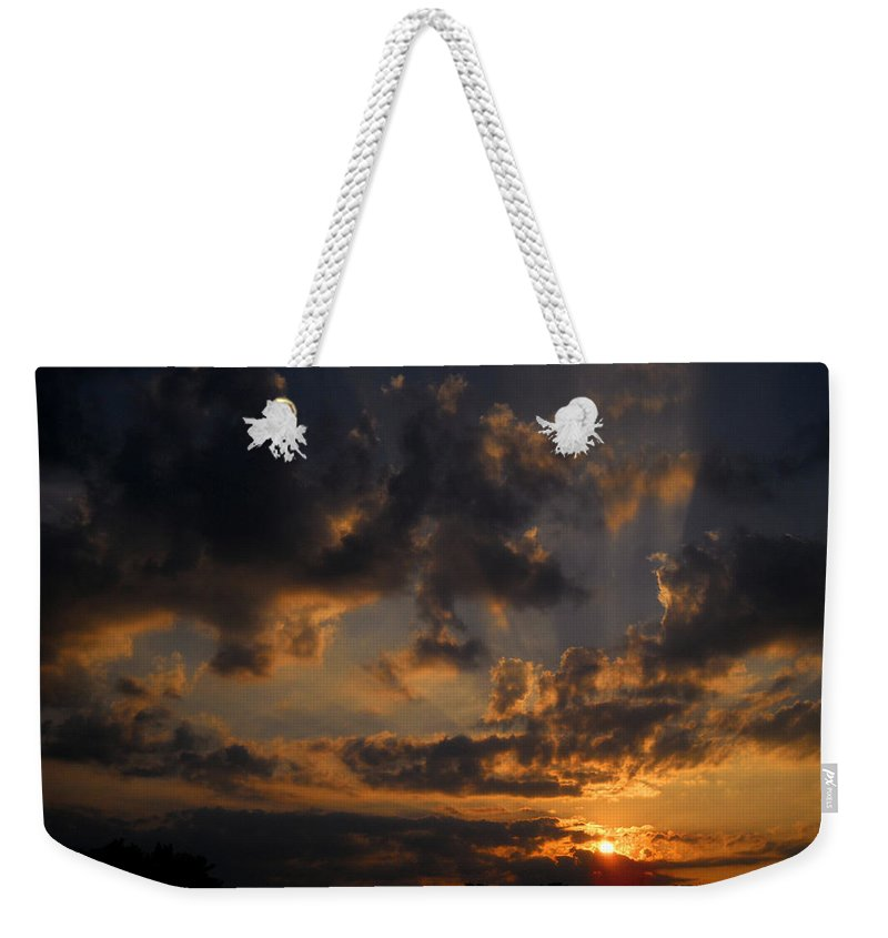 Sunset Weekender Tote Bag featuring the photograph Light In The Darkness by Amanda Jones