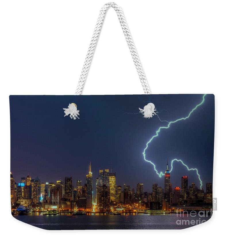 Clarence Holmes Weekender Tote Bag featuring the photograph Lightning Over New York City Vii by Clarence Holmes