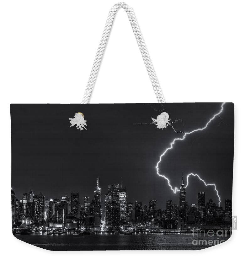 Clarence Holmes Weekender Tote Bag featuring the photograph Lightning Over New York City Viii by Clarence Holmes